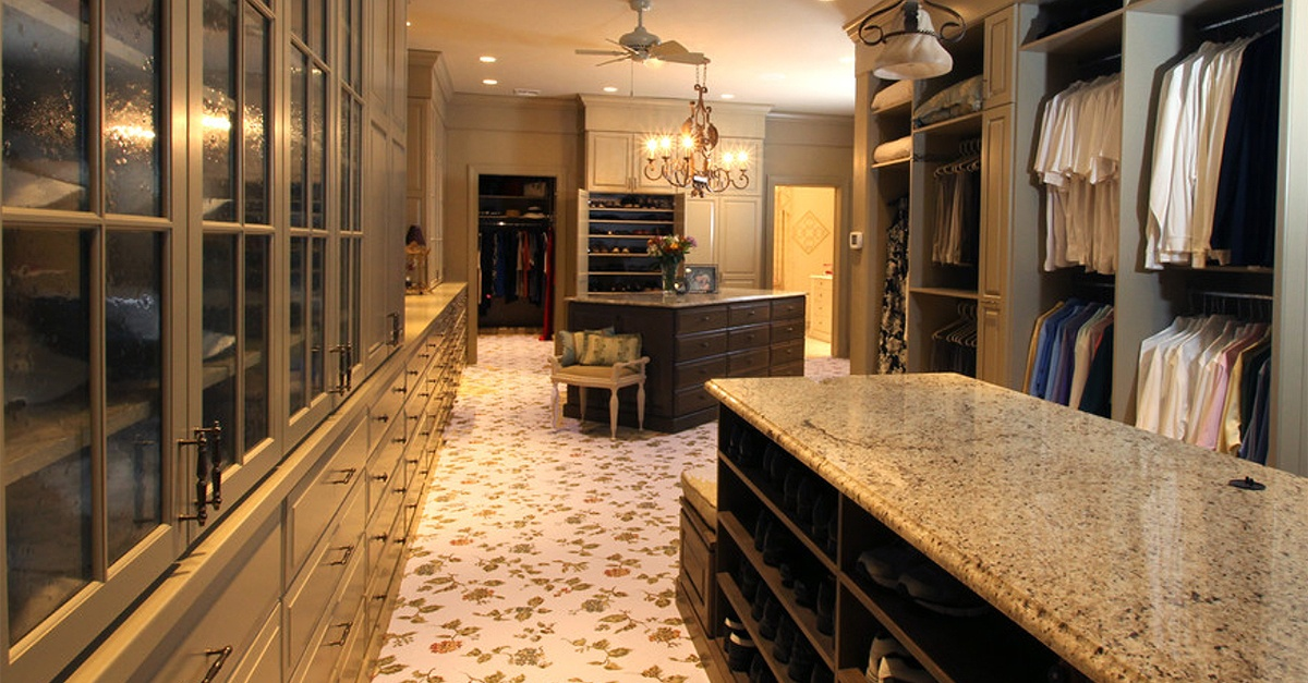 Luxurious room-sized closet with ample storage and granite countertops.