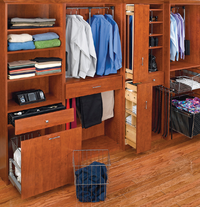 An organized closet with shelves, drawers, and racks.