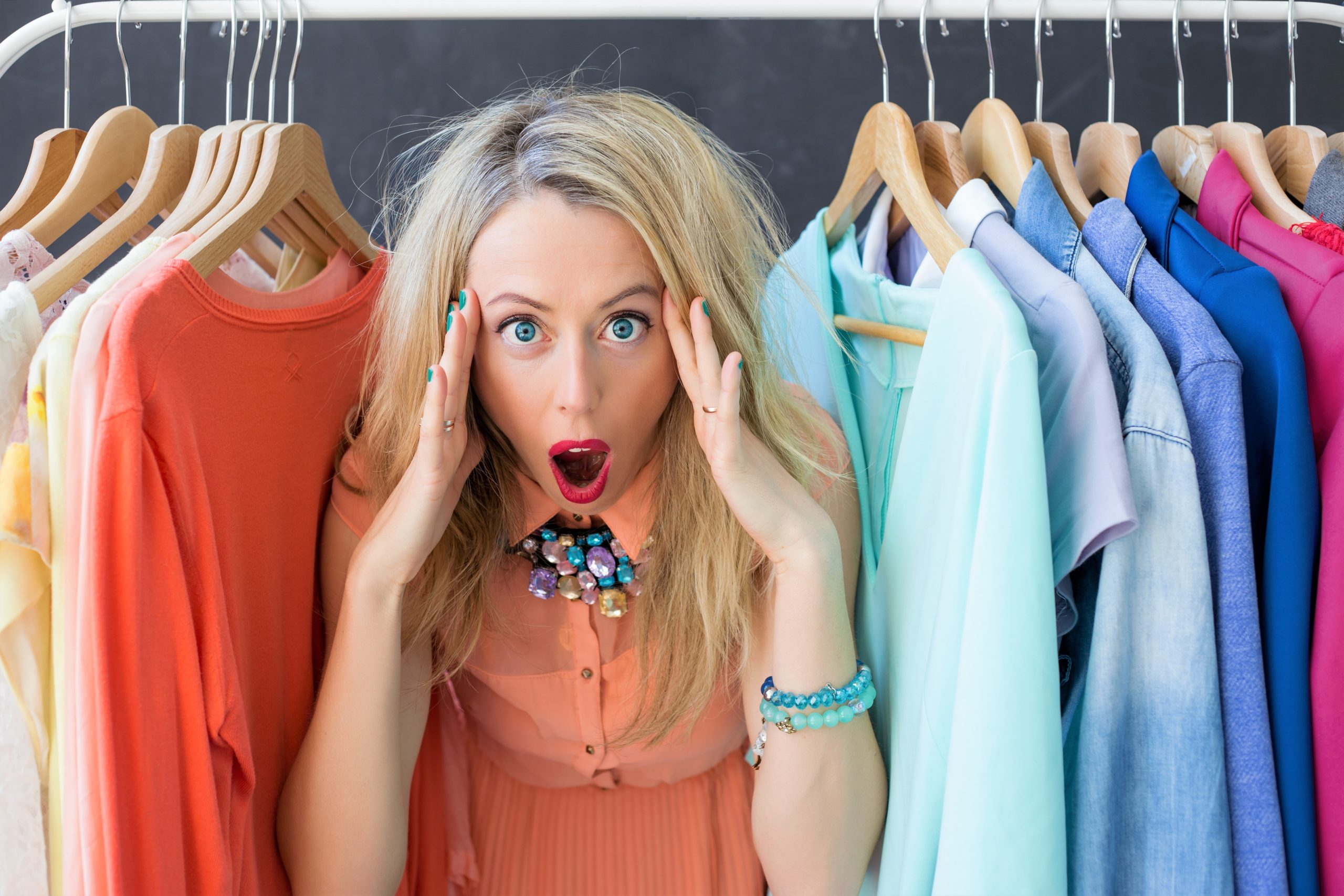 Stressed out woman in her clothes closet.